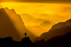 silhouette-man-top-mountain-sunset-conceptual-sce-scene-48015806